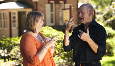 two people communicating using auslan