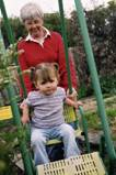 image of child on swing with adult