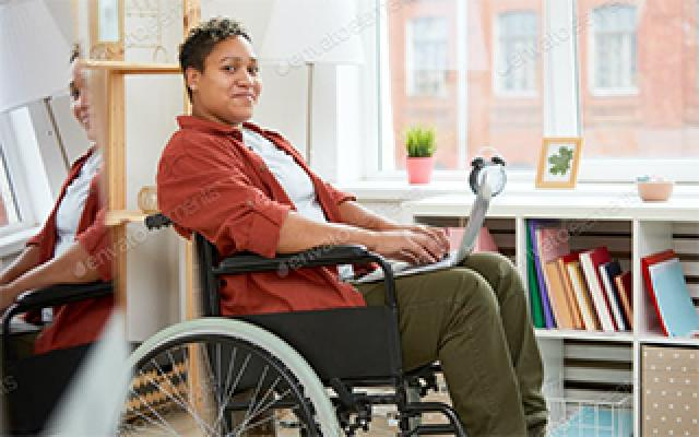 women in wheelchair communicating on laptop